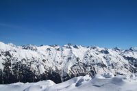 Snow covered mountains and blue clear sky