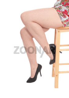 The legs of a young woman sitting