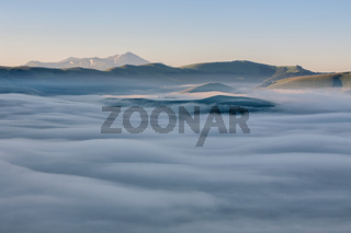 Above the fog, Castelluccio, Italy