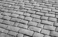 Old English cobblestone road close up.
