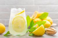 Lemonade. Drink with fresh lemons. Lemon cocktail with juice and ice.