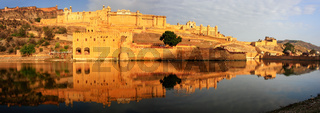 Panorama of Amber Fort reflected in Maota Lake near Jaipur, Rajasthan, India.