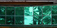 Large green glass windows in the city shopping center
