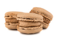 Three brown french macaroon cookies