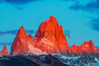 The cliffs Fitz Roy in crimson light of sunset