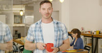 Man with coffee in office
