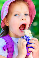 girl eating chocolate wafers - chocolate bar