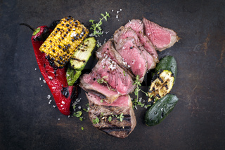 Barbecue New York Strip Steak with Vegetable on old Metal Sheet