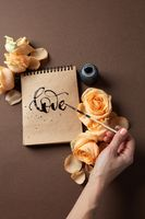 Hand with brush writing a love letter