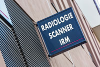 Sign on building indicating radiology MRI and medical scan services (