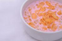 Bowl of fresh yogurt with granola and dried fruit