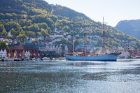 View of Bergen harbor in Norway with a sailing ship