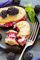 Homemade ice cream cookie sandwich with blackberry.