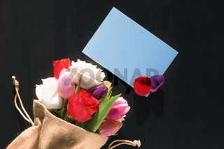Flower bouquet and mesage card with petals