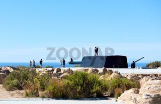 Tourists at the Castillitos Battery. Massive guns that defended Cartagena Bay. Murcia. Spain