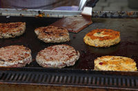 Close up beef burgers for hamburger on bbq grill