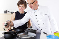 Woman with Chef Cook in the kitchen