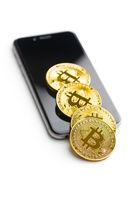 Bitcoin lies on a smartphone.