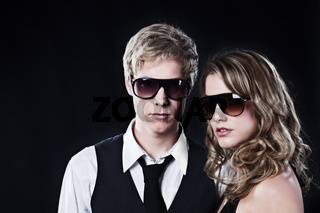 Glamour couple in sunglasses