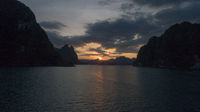 Boat trip on lake water of tropical lake, mountains, cliffs and rocks during sunset