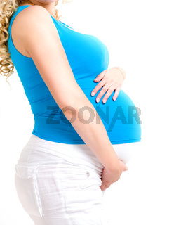 pregnant woman showing her big tummy