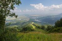 Beautiful summer view from Mount Tserkovka to resort of Belokurikha in the Altai Krai