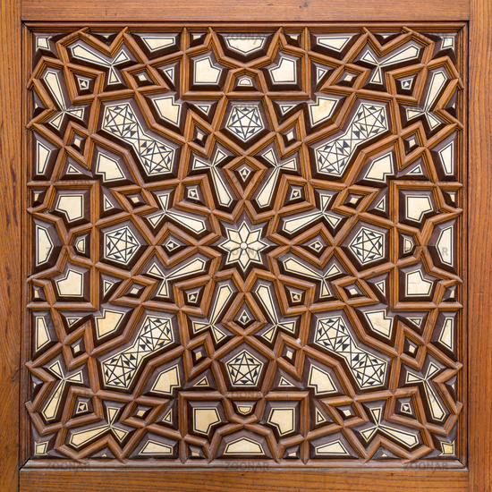 Closeup of arabesque ornaments of an old aged decorated wooden door