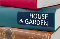 A book with the title House and Garden written on the spine