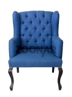 French blue wingback armchair with dark brown wooden legs isolated on white background including clipping path
