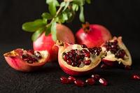 Closeup of ripe pomegranate fruits and seeds