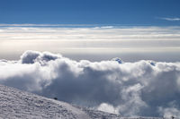 Snowy ski slope and beautiful sky with clouds at evening