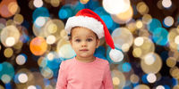 little baby girl in santa hat at christmas