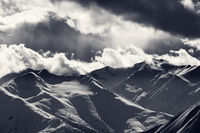 Evening mountains and cloudy sky with sunrays