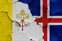 flag of Vatican and Iceland painted on cracked wall
