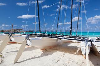 Catamarans on the empty beach, Cuba
