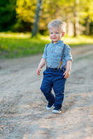 Toddler child outdoors. Rural scene with one year old baby boy