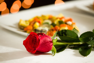 Red rose for a romantic dinner