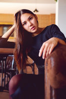 Young brunette sitting in a restaurant