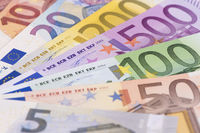 group of many Euro banknotes laying on table
