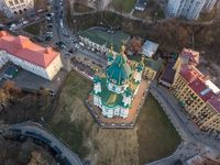 Beautiful view of the ancient street Andrew's Descent and the St. Andrew's Church in Kyiv