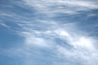 Clear blue sky with plain white cloud with space for text background. The vast blue sky and clouds