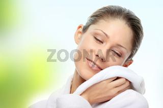 Young beautiful woman in bathrobe