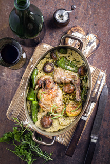 Rabbit with Vegetable and Mushrooms in White Wine Cream Sauce as top view in a Stewpot