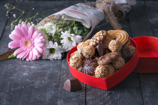 Heart shaped box with sweets and flowers