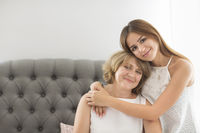 Mature woman embrace with young teen girl