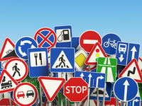 Traffic road signs on the sky background.