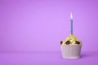 purple cupcake with a candle