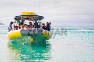 Tourist speed boat in turquoise waters