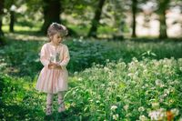 Portrait of beautiful little girl in park