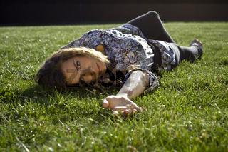 Cute Blond Girl Lying Back On Grass